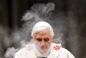 Incense smoke surrounds Pope Benedict XVI as he leads a solemn mass in Saint Peter's Basilica at the Vatican