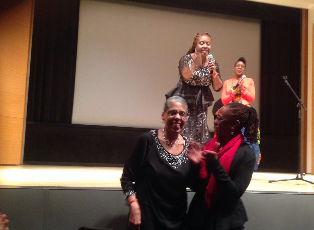 Farah Tanis and Mayowa Alero Obasaju celebrating pioneering feminists Barbara Smith and First Lady of New York City Chirlane McCray at Mother Tongue Monologues 2014 (photo credit: Aishah Shahidah Simmons)