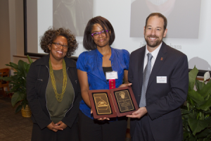 Karma Bambara Smith (center) accepts the Georgia Writers Hall of Fame award honoring her mother, Toni Cade Bambara (1939-1995), from professor Barbara McCaskill and librarian Toby Graham. source: http://bit.ly/1xWViTT