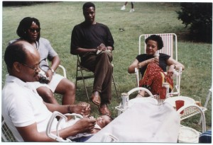 L-R Lamar Williams (with baby Ayodigi), June Givanni, Manthia Diawara, Toni Cade Bambara at the home of Frederica Massiah Jackson photograph: © Louis Massiah, 1991