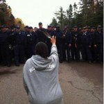 In 2013, Mi'kmaq mother Amanada Polchies made international news when kneeling in front of a line of police, raising a feather in her hand at an anti-fracking barricade in New Brunswick Canada.