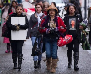 Families of the missing women march as they make their way in to review the report from the Missing Women Commission of Inquiry in Vancouver. (Source: John Lehmann/The Globe and Mail)