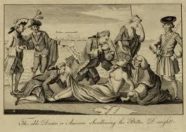 """This image, known as """"The able doctor, or America swallowing the bitter draught"""" (1774), shows an Indigenous woman being harassed by European colonizers and their imperialist agenda."""