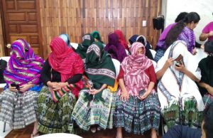 Maya Q'eqchi' women in the courtroom negotiating the space on their own terms by protecting their identities with their rebosos. Photo: Jo-Marie Burt.
