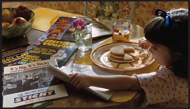 Still frame of Matilda eating pancakes from the 1996 film, Matilda.