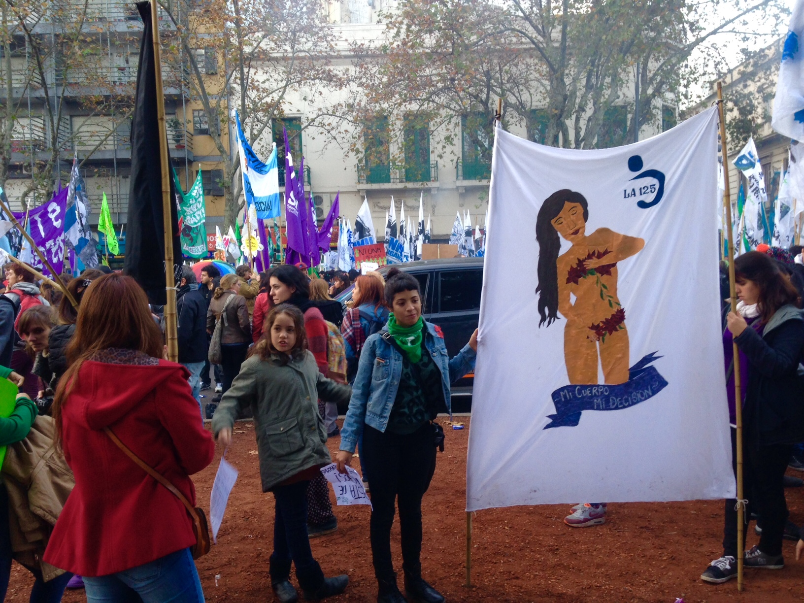 Photo credit: Fiona Gilligan. Protestors with art and murals.